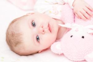 baby girl waking up from her nap best organic crib mattress - Crib Mattress Reviews